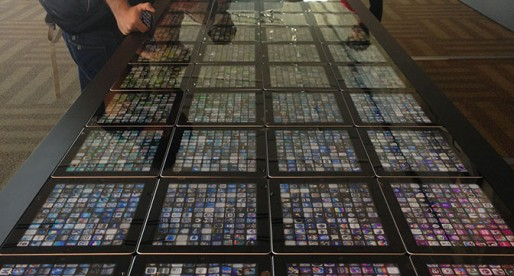 The giant iPad table showing top-selling apps and their downloads in realtime.