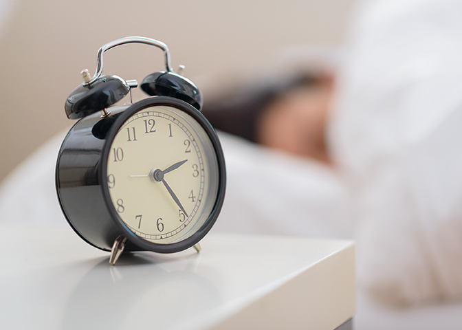 bigstock-Alarm-Clock-In-Front-Of-A-Pers-43909945