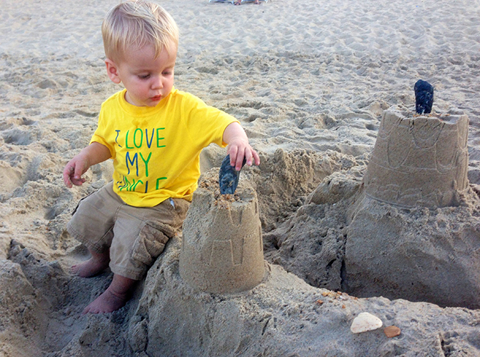 I hope the kid that built and abandoned this sandcastle wasn't attached to it, because Evan destroyed it two seconds later.