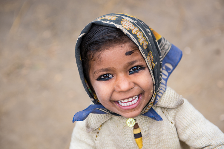 A young girl smiles for the camera in the village of Marchwar, Nepal. CARE USA representatives have come to the area to view the progress of the Tipping Point Program, meant to combat child marriage in the districts of Kapilbastu and Rupandehi of Nepal near the Indian border.