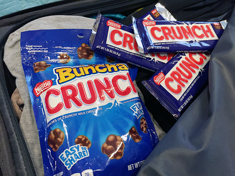 Nestlé® Crunch® in suitcase